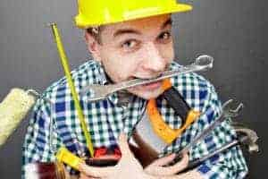 photo of repairman carrying tools to illustrate the need to plan you r website properly